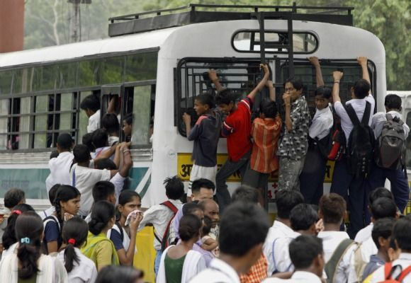 School children travel on an over-crowded bus in New Delhi.