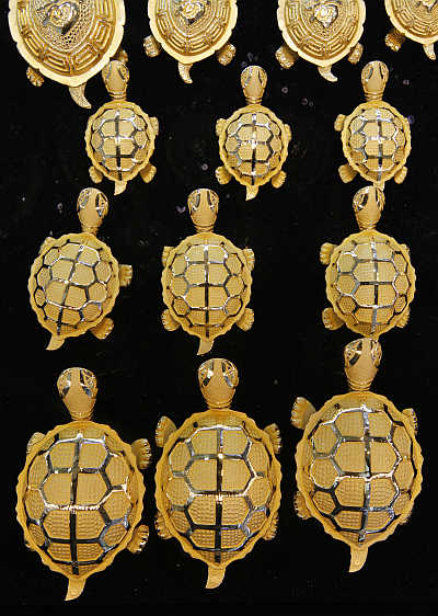 Gold turtles are displayed at a jewellery shop.