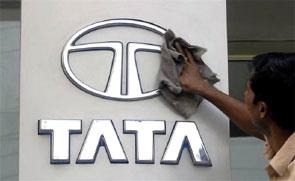A worker cleans a Tata Motors logo outside its showroom in Hyderabad. Photograph: Krishnendu Halder/Reuters
