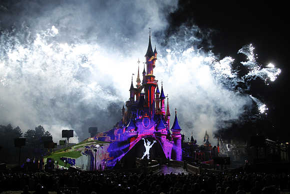 Crowd watches the premiere of Disney Dreams show as part of the 20th anniversary celebrations of Disneyland Resort in Marne-la-Vallee, outside Paris, France.
