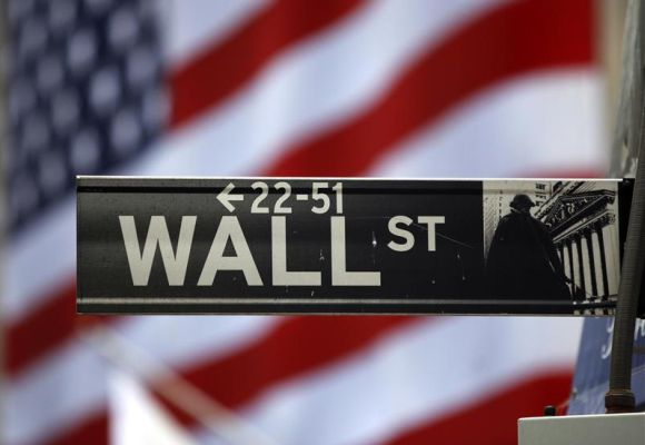The Wall Street sign is seen outside the New York Stock Exchange.