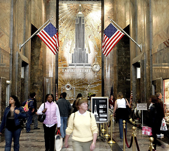 People walk through the lobby of the Empire State Building on its 75th birthday May 1, 2006 in New York City.