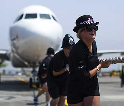Members of London's Metropolitan Police Ladies tug an Airbus A320 jet for 100 feet during a race at John F Kennedy International Airport in New York. The annual race is a fundraising competition to benefit the charity Joining Against Cancer in Kids.