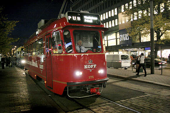 A tram that has been converted into a rolling pub combines sightseeing with a night on the town in Helsinki, Finland.