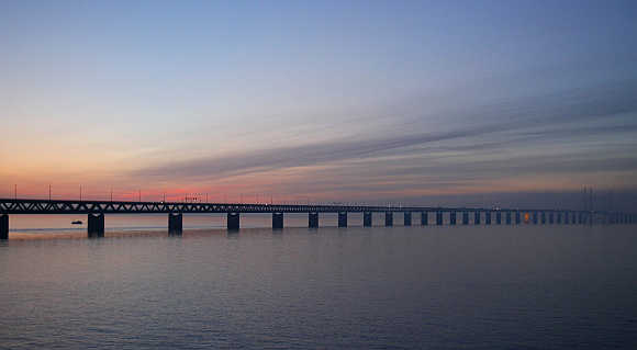 Cars travel along the Oresund Bridge. The bridge, which links the city of Malmo in Sweden to Copenhagen, the capital of Denmark, has a total length of 7,845m.