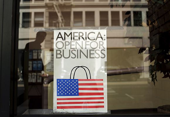 A sign is shown in the window of a retail store in San Francisco.