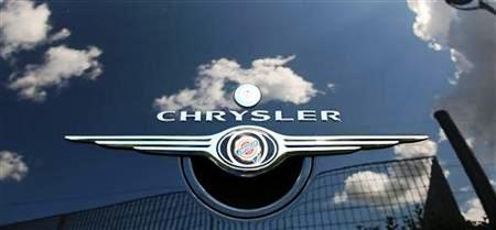 Clouds are reflected on a Chrysler PT Cruiser at a Chrysler dealership in Rome.