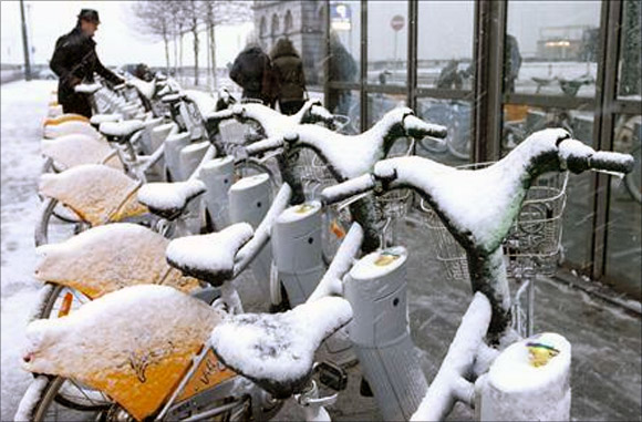 Rental bikes covered with snow in central Brussels.