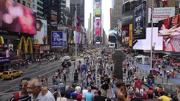 Tourists gather in Times Square in New York City.