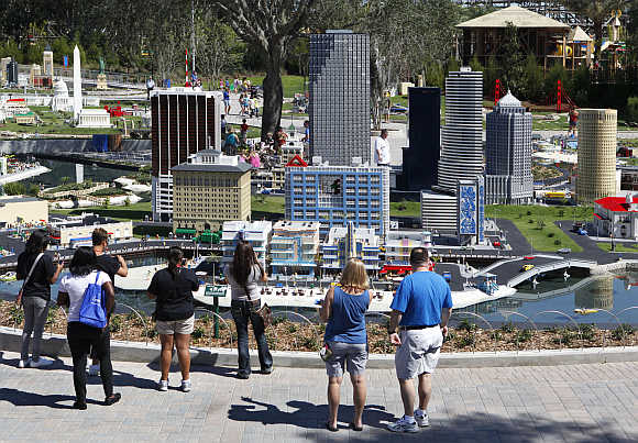 Visitors look at a model of Miami Beach, constructed out of lego bricks, displayed at Legoland Florida during its grand opening celebration in Winter Haven, Florida.
