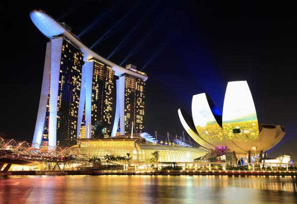 Singapore's The Marina Bay Sands hotel, left, and ArtScience Museum, right.