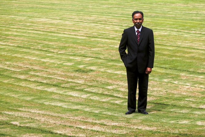 S D Shibulal poses for a picture on a lawn inside Infosys campus in Bengaluru.