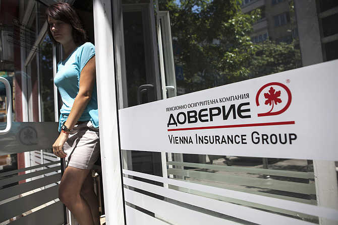 An employee walks out of an office of Doverie, the country's biggest private pension fund, in Sofia, Bulgaria.