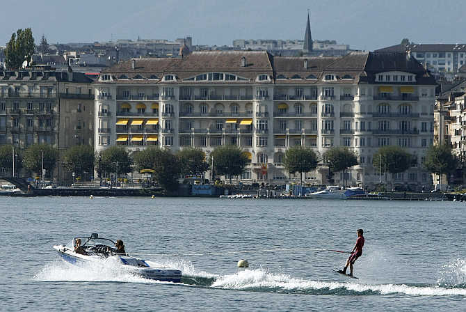 A wakeboarder performs on Lake Leman on a hot autumn day in Geneva, Switzerland.