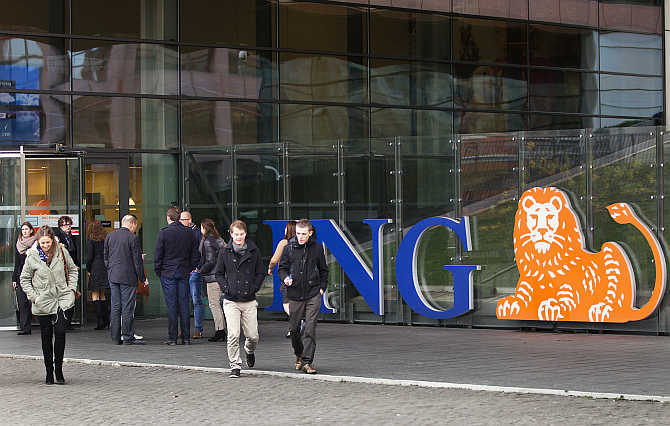 Employees of ING group during their lunch break in front of their office in Amsterdam, the Netherlands.
