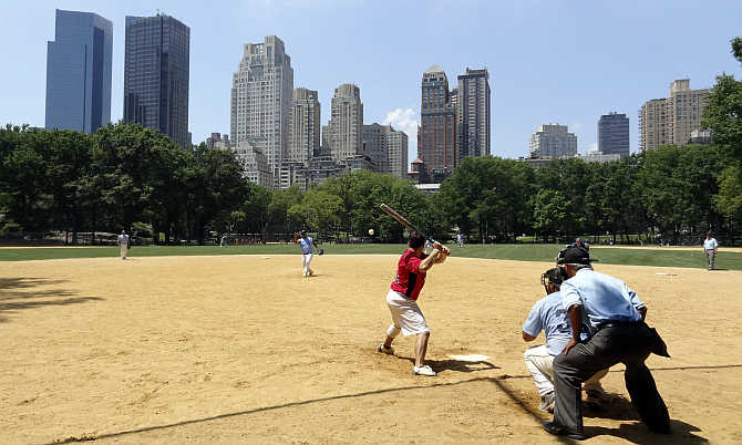 A game of baseball is on in Central Park in New York City, United States.