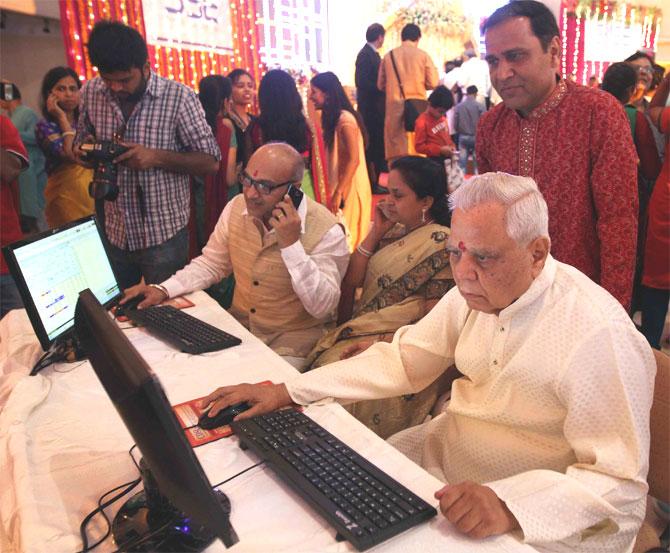 Samvat 2070 off to flying start; Sensex, Nifty end at new highs
