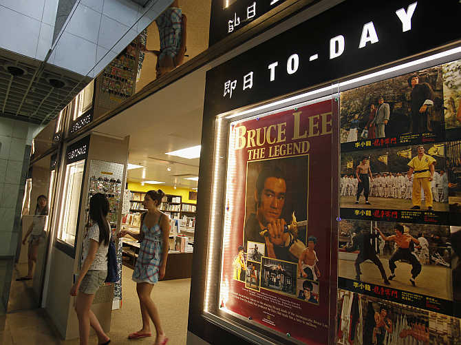 Visitors leave a souvenir store at the Hong Kong Heritage Museum promoting a five-year exhibition on the late Kung Fu legend Bruce Lee.