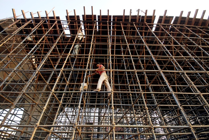 Labourers erect scaffolding at a construction site in Hyderabad.