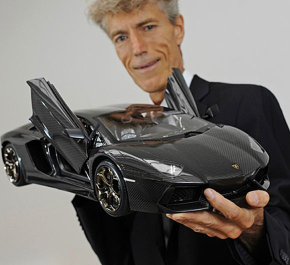 Robert Gulpen holding the prototype of Lamborghini Aventador.