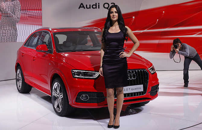 Bollywood actress Katrina Kaif poses with Audi's SUV Q3 in New Delhi.