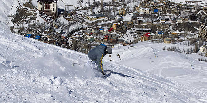 A snowboarder navigates the slope at the ski resort in Shemshak, 50km northeast of Tehran, Iran.