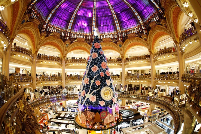 A giant Christmas tree stands in the middle of the Galeries Lafayette department store in Paris ahead of the holiday season   in the French capital, November 6, 2013.