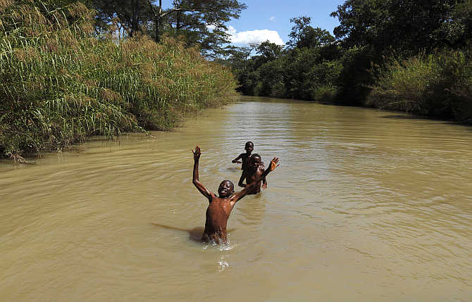 Children swim in a river close to the town of Chikuni in the south of Zambia.