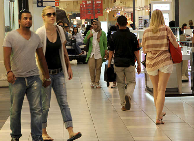 People shop in Ibn Battuta Mall in Dubai, United Arab Emirates.