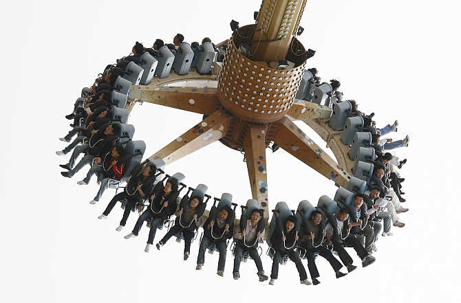 People enjoy a ride at an amusement park in Dalian, Liaoning province, China.