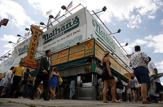 Customers at Nathan's hot dog stand in the Coney Island section of New York, United States.