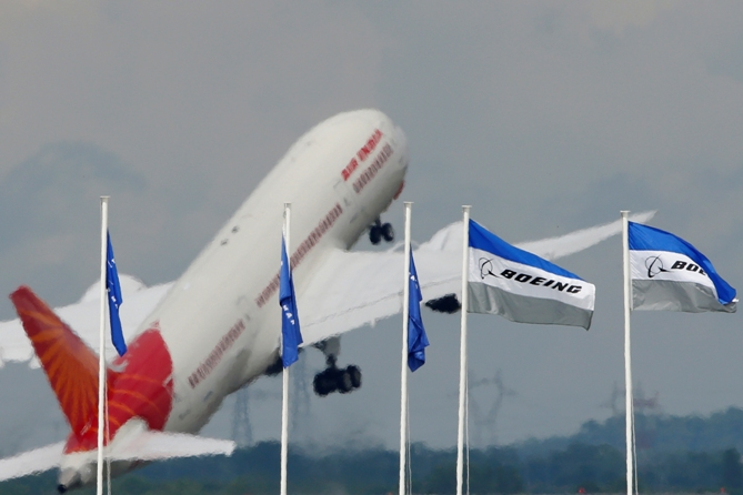 An Air India Boeing 787 Dreamliner prepares for a flying display, during the 50th Paris Air Show, at the Le Bourget airport near Paris,