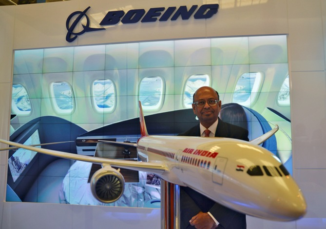 Dinesh Keskar, Boeing's vice-president for sales in Asia Pacific and India, poses with a model of 787 Dreamliner during 'Aero India 2013' on the outskirts of Bengaluru.