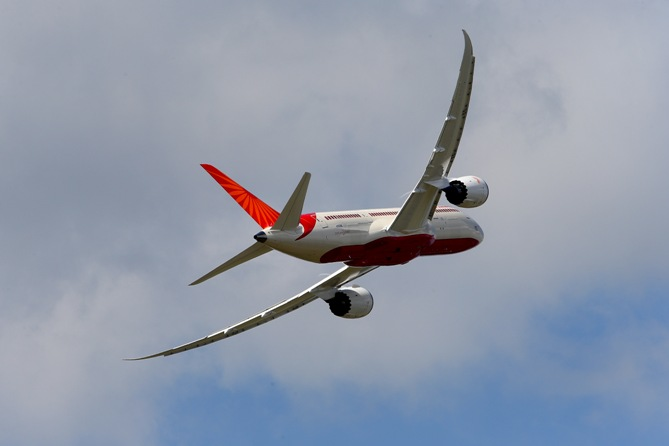 An Air India Airlines Boeing 787 dreamliner takes part in a flying display.