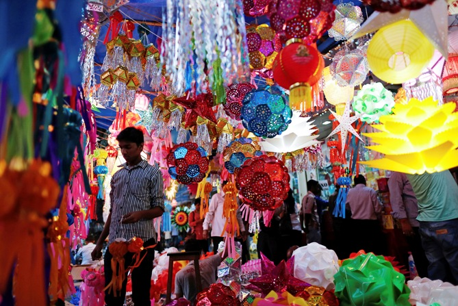 A vendor stands under lanterns for sale at a Diwali market in Mumbai.