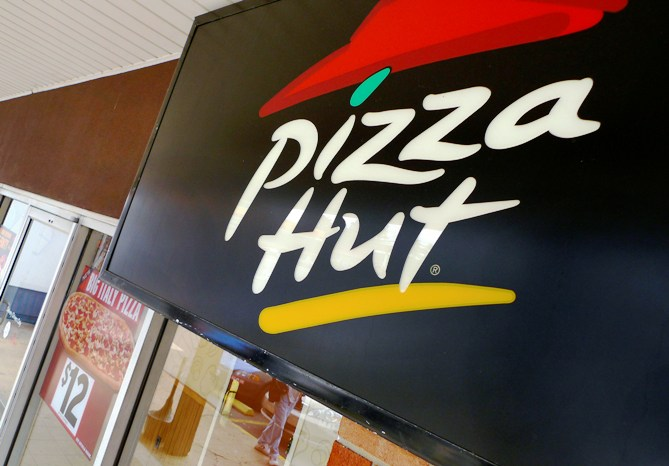 A Pizza Hut logo is pictured outside its restaurant in Vienna.