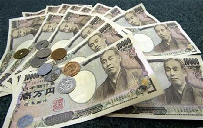 Japanese 10,000 yen bank notes and coins.