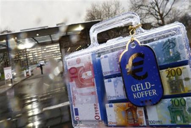 A money suitcase (Geldkoffer) containing chocolate euro notes is pictured outside the headquarters of Germany's federal bank Deutsche Bundesbank.