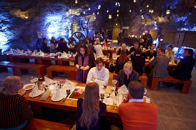Customers eat their dinner at Muru Pop Down restaurant at Tytyri mine in Lohja, Finland.