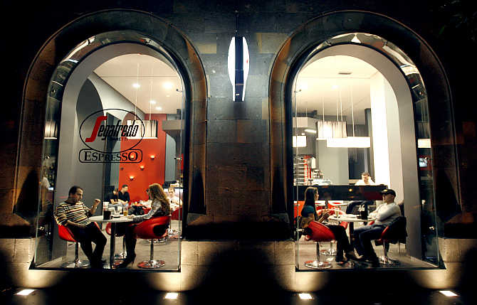 People sit in a cafe along a street in Yerevan, Armenia.