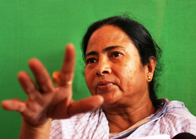 A file photograph shows Trinamool Congress chief and West Bengal Chief Minister Mamata Banerjee speaking with the media during a protest in front of the main entrance of the Tata car plant in Singur.