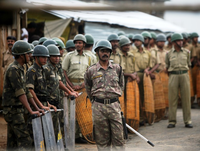 A file photograph shows riot policemen standing guard inside the main entrance of the Tata car plant in Singur.
