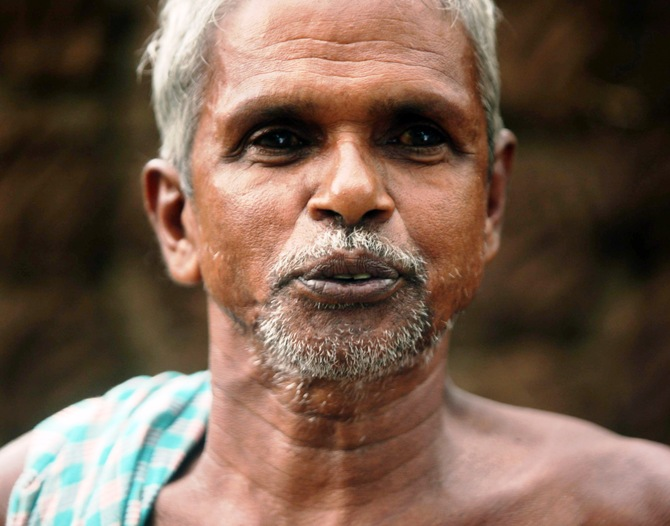 Laxman Das, an elderly farmer, says he lost his land and was refused compensation.