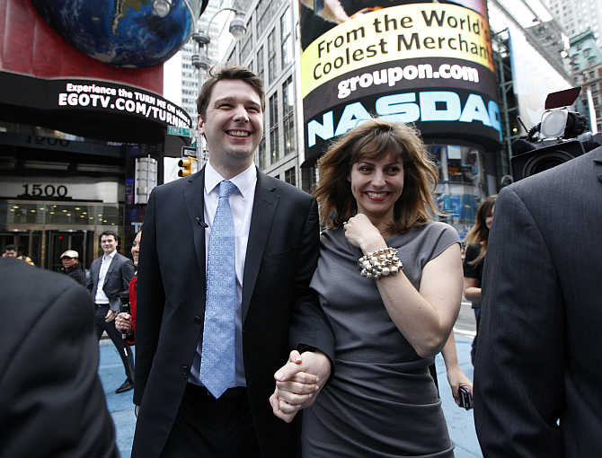 Groupon Chief Executive Andrew Mason with his wife, pop musician Jenny Gillespie, outside the Nasdaq Market following his company's IPO in New York.