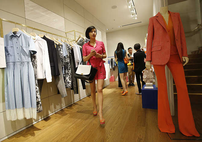 A woman browses merchandise at Stella McCartney's free-standing boutique in Beijing, China.
