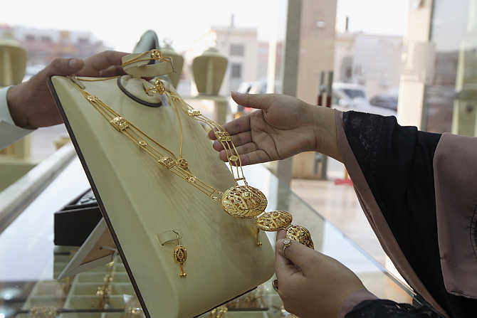 A woman looks at jewellery in the gold market in Riyadh, Saudi Arabia.