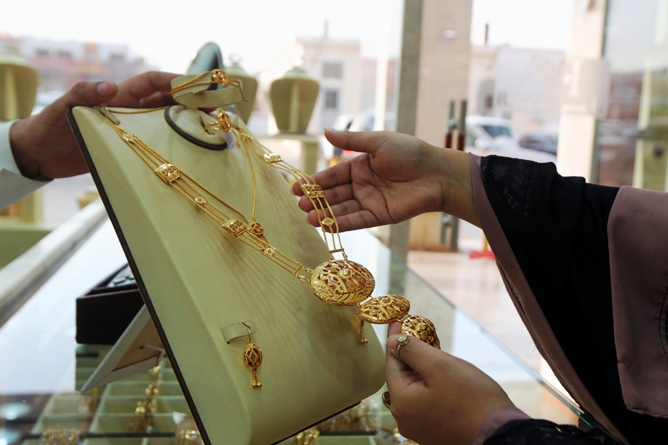 A woman looks at jewellery at a shop.