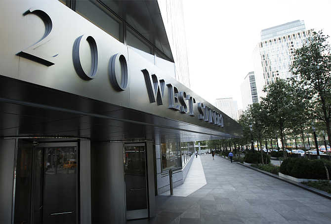 A sign shows the address of the Goldman Sachs headquarters building in New York.