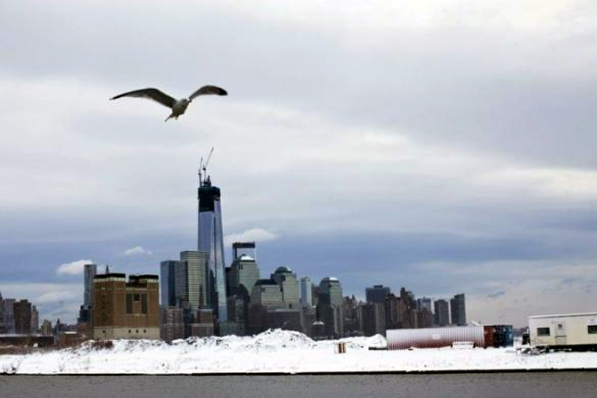 Skyline of New York's Lower Manhattan and One World Trade Center after the passing of a winter storm in Newport in New Jersey