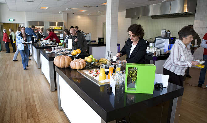 Customers pick their food in the 'restaurant of the future' at the Dutch University of Wageningen, eastern Netherlands. The university has opened a 'big brother' restaurant where academics and companies can study consumer behaviour by tracking diners on cameras to test their reactions to food products, packaging and restaurant design.